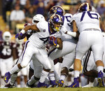 LSU running back Nick Brossette (4) runs the ball during an NCAA college football game against Mississippi State in Baton Rouge, La., Saturday, Oct. 20, 2018. (AP Photo/Tyler Kaufman)