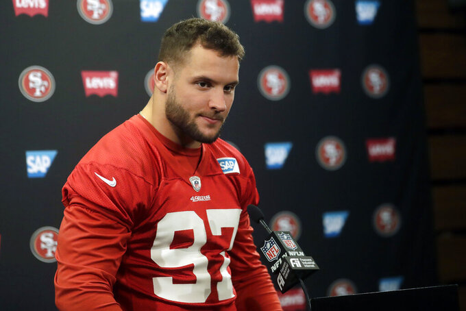 FLE - In this Jan. 23, 2020, file photo, San Francisco 49ers defensive end Nick Bosa speaks at a news conference at the team's NFL football training facility in Santa Clara, Calif. Bosa is doing his best to make an uncertain offseason as normal as possible. Forced to be training back at home in South Florida with his Pro Bowl brother Joey instead of his San Francisco 49ers teammates, the younger Bosa has found a routine amid the COVID-19 pandemic.(AP Photo/Jeff Chiu, File)