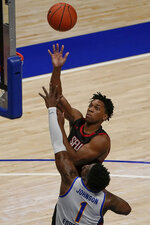 St. Francis's Ramiir Dixon-Conover (2), top, shoots over Pittsburgh's Xavier Johnson (1) during the second half of an NCAA college basketball game, Wednesday, Nov. 25, 2020, in Pittsburgh. St. Francis won 80-70. (AP Photo/Keith Srakocic)