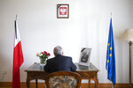 Istvan Nagy, Ambassador of Hungary to Switzerland, signs the condolence book for Pawel Adamowicz, Mayor of Gdansk, at the residence of Poland's Ambassador in Switzerland in Bern, Switzerland, Friday, Jan. 18, 2019. The Polish embassy opened a condolonce book after the tragic death of Pawel Adamowicz, Mayor of Gdansk. (Peter Klaunzer/Keystone via AP)