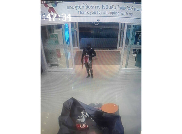 FILE - This Thursday, Jan. 9, 2020, file image made from a security camera video and provided by Royal Thai Police Crime Suppression Division, shows a person alleged to have shot dead people at a gold shop robbery in a mall in Thailand's central province of Lopburi. Thai police have arrested a man on suspicion of a ruthless triple killing, including that of a toddler, during a gold shop robbery earlier this month that shocked the country.  Local media reported the suspect was the director of a primary school. (Royal Thai Police Crime Suppression Division via AP, File)