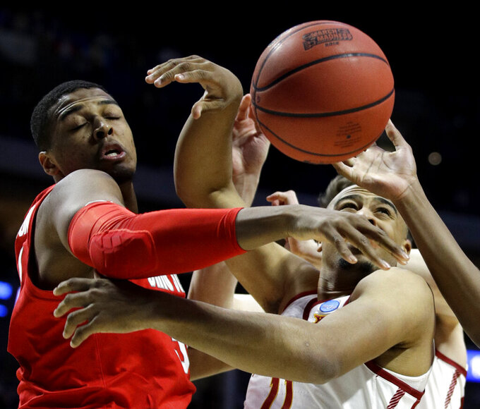 Ohio State's Keyshawn Woods, left, and Iowa State's Nick Weiler-Babb battle for a rebound during the first half of a first round men's college basketball game in the NCAA Tournament Friday, March 22, 2019, in Tulsa, Okla. (AP Photo/Charlie Riedel)