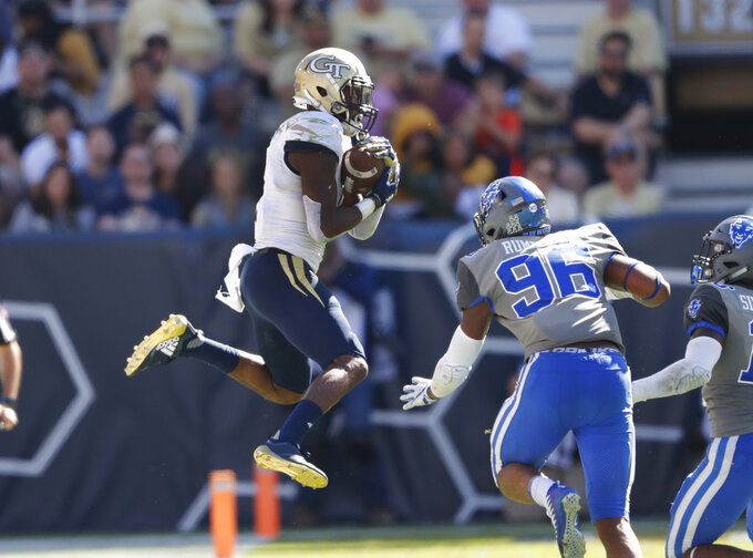 Georgia Tech running back Qua Searcy (1) makes a catch as Duke defensive end Chris Rumph II (96) defends during the second half of the an NCAA college football game, Saturday, Oct. 13, 2018, in Atlanta. Duke won 28-14. (AP Photo/John Bazemore)