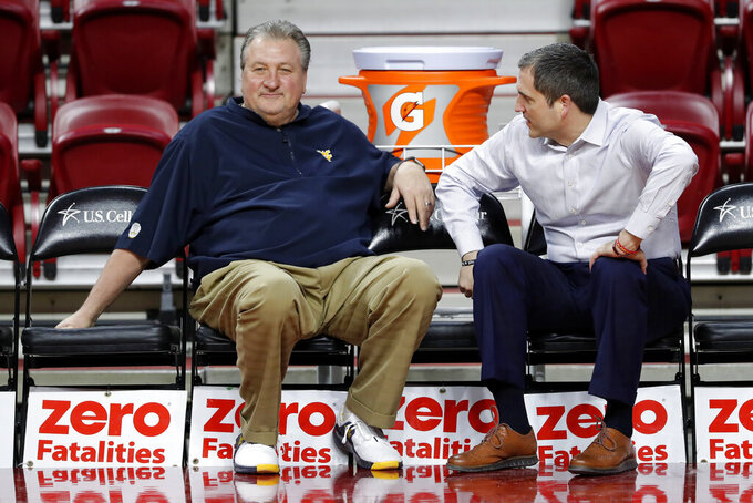 West Virginia head coach Bob Huggins, left, talks with Iowa State head coach Steve Prohm before an NCAA college basketball game, Wednesday, Jan. 30, 2019, in Ames, Iowa. (AP Photo/Charlie Neibergall)