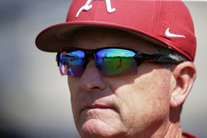 FILE -TD Ameritrade Park, home of the College World Series, is reflected in the sunglasses of Arkansas NCAA college baseball coach Dave Van Horn during team practice in Omaha, Neb., in this Friday, June 14, 2019, file photo. In 33 years as a head coach, Dave Van Horn couldn't recall winning a game quite the way his Arkansas Razorbacks did in the series finale at Mississippi. Their 18-14 victory Sunday, April 11, 2021, came after they squandered leads of 11-0 in the third inning and 14-6 in the sixth. (AP Photo/Nati Harnik, File)