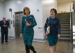 Sen. Lisa Murkowski, R-Alaska, left, and Sen. Susan Collins, R-Maine, walk together following a vote at the Capitol in Washington, Wednesday, Feb. 12, 2020. (AP Photo/J. Scott Applewhite)