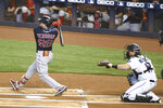 Boston Red Sox centerfielder Alex Verdugo hits a single to right field during the first inning of a baseball game against the Miami Marlins, Thursday, Sept. 17, 2020, in Miami. (AP Photo/Gaston De Cardenas)