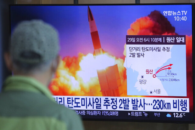A man watches a TV screen showing a file image of North Korea's missile launch during a news program at the Seoul Railway Station in Seoul, South Korea, Sunday, March 29, 2020. North Korea on Sunday fired two suspected ballistic missiles into the sea, South Korea said, calling it