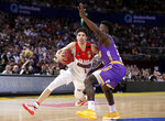 FILE - In this Nov. 17, 2019, file photo, LaMelo Ball of the Illawarra Hawks drives past Jae'Sean Tate of the Sydney Kings during their game in the Australian Basketball League in Sydney, Australia. LaMelo Ball is expected to be one of the top picks in the NBA Draft, Wednesday, Nov. 18, 2020. (AP Photo/Rick Rycroft, File)