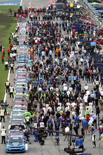 Cars, drivers and crews are lined up on pit road before the NASCAR Cup Series auto race at Daytona International Speedway, Saturday, Aug. 28, 2021, in Daytona Beach, Fla. (AP Photo/David Graham)