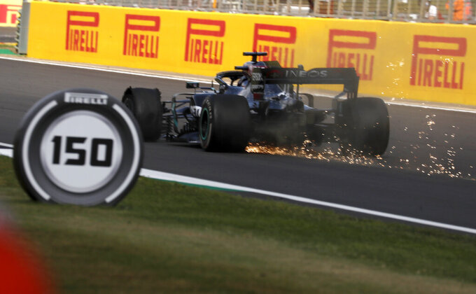 Mercedes driver Lewis Hamilton of Britain steers his car with flat tire during the British Formula One Grand Prix at the Silverstone racetrack, Silverstone, England, Sunday, Aug. 2, 2020. (AP Photo/Frank Augstein, Pool)