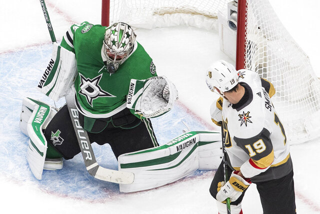 Dallas Stars goalie Anton Khudobin makes a save on Vegas Golden Knights' Reilly Smith (19) during the first period of Game 4 of the NHL hockey Western Conference final, Saturday, Sept. 12, 2020, in Edmonton, Alberta. (Jason Franson/The Canadian Press via AP)