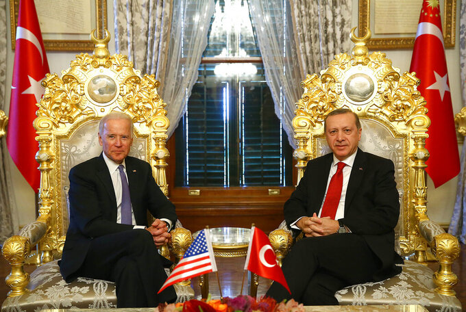 FILE - In this Jan. 23, 2016, file photo, U.S. Vice President Joe Biden, left, poses for photographers with Turkish President Recep Tayyip Erdogan, right, prior to their meeting at Yildiz Mabeyn Palace in Istanbul. Biden and Turkish counterpart Erdogan have known each other for years, but their meeting Monday, June 14, 2021, will be their first as heads of state. And it comes at a particularly tense moment for relations between their two countries. (Kayhan Ozer/Presidential Press Service, Pool via AP, File)