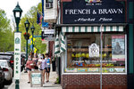 Shops that cater to tourists start to reopen under strict guidelines to help prevent the spread of coronavirus, Thursday, May 28, 2020, in Camden, Maine. The pandemic has meant a sharp drop in the number of tourists visiting the state's coastal towns. (AP Photo/Robert F. Bukaty)