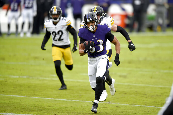 Baltimore Ravens wide receiver Willie Snead runs with the ball after making a catch against the Pittsburgh Steelers during the first half of an NFL football game, Sunday, Nov. 1, 2020, in Baltimore. (AP Photo/Gail Burton)