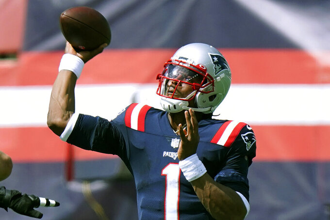 New England Patriots quarterback Cam Newton passes against the Miami Dolphins in the second half of an NFL football game, Monday, Sept. 14, 2020, in Foxborough, Mass. (AP Photo/Steven Senne)