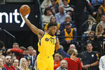 Utah Jazz guard Donovan Mitchell (45) reaches for a pass in the first half during an NBA basketball game against the Minnesota Timberwolves Monday, Nov. 18, 2019, in Salt Lake City. (AP Photo/Rick Bowmer)