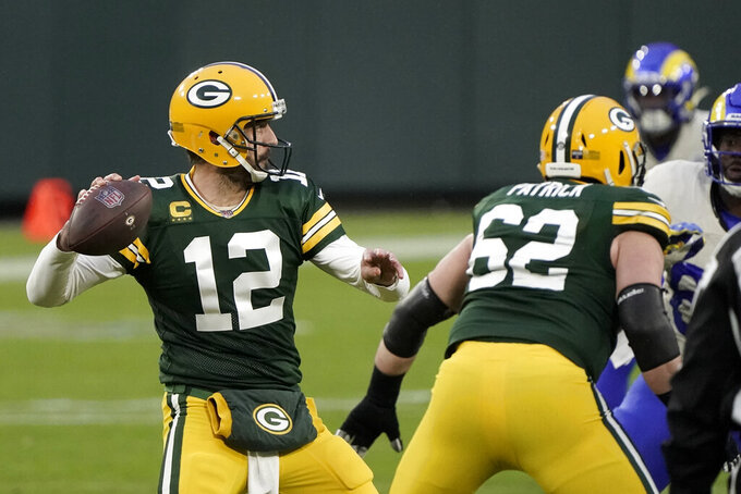 Green Bay Packers quarterback Aaron Rodgers passes during the first half of an NFL divisional playoff football game against the Los Angeles Rams Saturday, Jan. 16, 2021, in Green Bay, Wis. (AP Photo/Morry Gash)