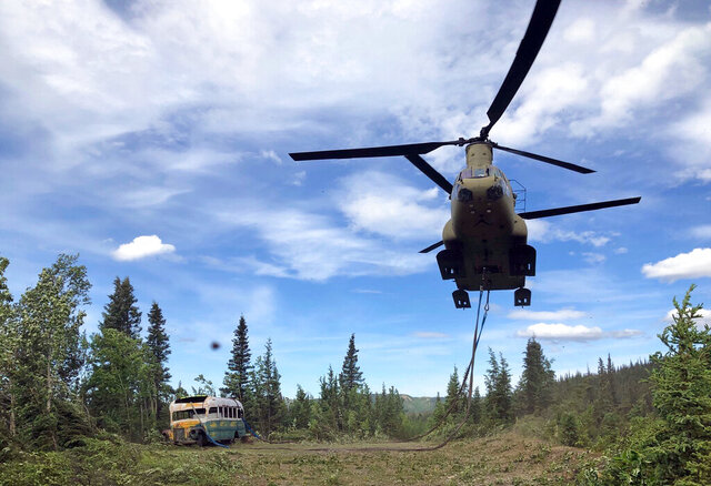 FILE - In this June 18, 2020, file photo released by the Alaska National Guard, Alaska Army National Guard soldiers use a CH-47 Chinook helicopter to remove an abandoned bus, popularized by the book and movie