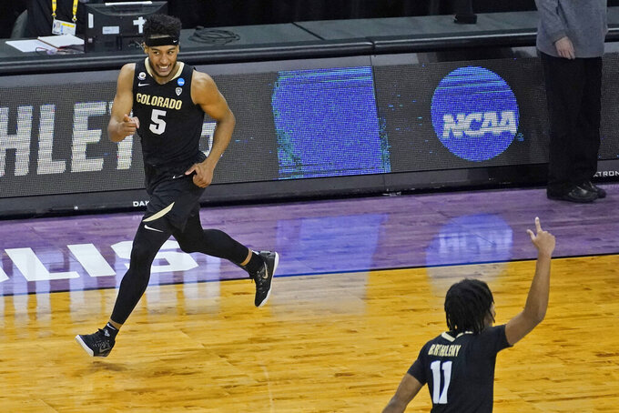 Colorado guard D'Shawn Schwartz (5) reacts to a three point shot during the second half of a second-round game against Colorado in the NCAA college basketball tournament at Farmers Coliseum in Indianapolis, Monday, March 22, 2021. (AP Photo/Charles Rex Arbogast)