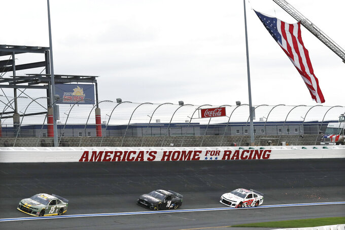 Brennan Poole (15), BJ McLeod (78) and Garrett Smithley (53) drive during the NASCAR Cup Series auto race at Charlotte Motor Speedway Sunday, May 24, 2020, in Concord, N.C. (AP Photo/Gerry Broome)