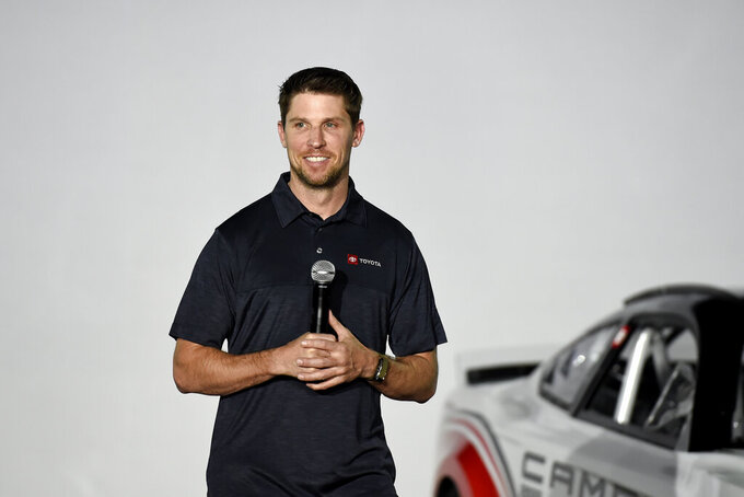 Driver Denny Hamlin talks about Toyota Camry Next Gen Cup car that will be used in the 2022 season during the NASCAR media event in Charlotte, N.C., Wednesday, May 5, 2021. (AP Photo/Mike McCarn)