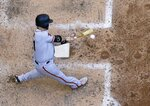 San Francisco Giants' Stephen Vogt hits an RBI double during the seventh inning of a baseball game against the Milwaukee Brewers Sunday, July 14, 2019, in Milwaukee. (AP Photo/Morry Gash)