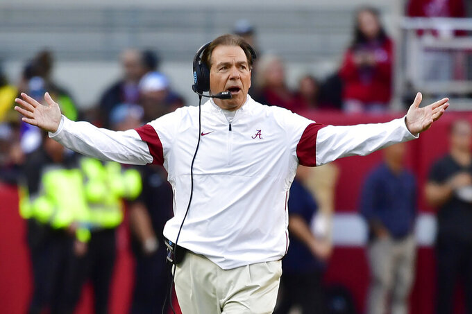 FILE - In this Nov. 9, 2019, file photo, Alabama coach Nick Saban reacts during the first half of the team's NCAA college football game against LSU in Tuscaloosa, Ala. As Alabama, Ohio State, Clemson, Oregon, Notre Dame, Oklahoma and Florida prepared to play for conference championships, they signed top-10 recruiting classes for 2021 they hope to fuel their next title contenders.. (AP Photo/Vasha Hunt, File)