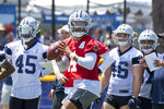 Dallas Cowboys quarterback Dak Prescott, center, passes during practice at the NFL football team's training camp in Oxnard, Calif., Thursday, July 22, 2021. (AP Photo/Michael Owen Baker)
