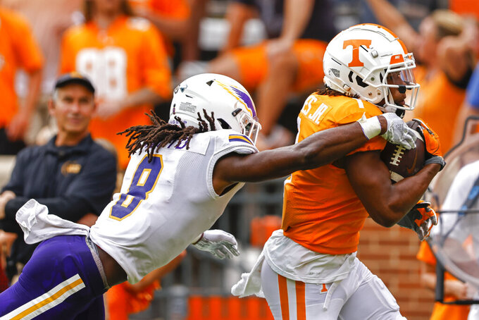 Tennessee wide receiver Velus Jones Jr. (1) runs the ball for a touchdown as he's hit by Tennessee Tech defensive back Jamaal Boyd (8) during the first half of an NCAA college football game Saturday, Sept. 18, 2021, in Knoxville, Tenn. (AP Photo/Wade Payne)