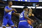 Seton Hall's Myles Cale (22) steals the ball from Marquette's Markus Howard, right, during the first half of an NCAA college basketball game Saturday, Feb. 29, 2020, in Milwaukee. (AP Photo/Aaron Gash)