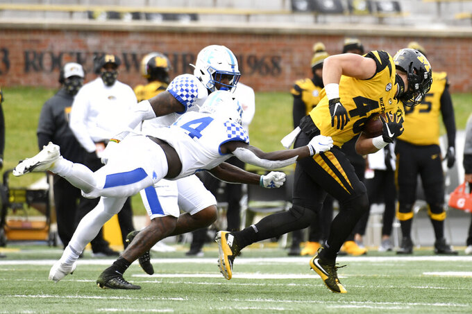 Missouri tight end Niko Hea, right, catches a pass as Kentucky linebacker Jamin Davis, left, defends during the first half of an NCAA college football game Saturday, Oct. 24, 2020, in Columbia, Mo. (AP Photo/L.G. Patterson)