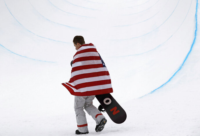 Gold medal winner Shaun White, of the United States, celebrates after finishing his run during the men's halfpipe finals at Phoenix Snow Park at the 2018 Winter Olympics in Pyeongchang, South Korea, Wednesday, Feb. 14, 2018.  (AP Photo/Lee Jin-man)