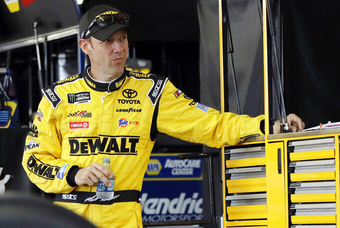 FILE - In this July 29, 2017, file photo, Matt Kenseth stands in his garage stall after practice for a NASCAR Cup series auto race in Long Pond, Pa. At 48, Kenseth will be the oldest driver in the field when racing resumes. (AP Photo/Matt Slocum, File)