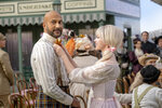 """This image released by Apple TV+ shows Keegan-Michael Key, left, and Dove Cameron in a scene from """"Schmigadoon!,"""" premiering Friday. (Apple TV+ via AP)"""