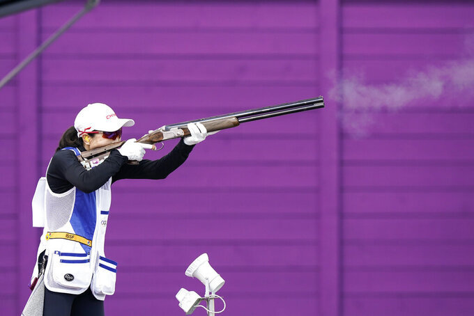 Wei Meng, of China, competes in the women's skeet at the Asaka Shooting Range in the 2020 Summer Olympics, Sunday, July 25, 2021, in Tokyo, Japan. (AP Photo/Alex Brandon)
