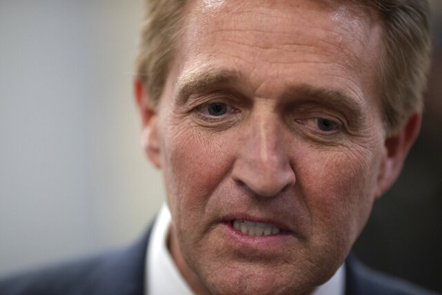 "FILE - In this Nov. 14, 2018, file photo, then-Sen. Jeff Flake, R-Ariz., speaks with reporters at the Capitol in Washington. Republicans are facing a reckoning as they contend with some divisive candidates during the country's struggle through civic unrest. ""He's driving away moderate Republicans and independents en masse,"" Flake, who retired last year after clashing with Trump, said in an interview Wednesday, June 3, 2020. ""For Republicans who need to appeal to a broader base, it's devastating."" (AP Photo/J. Scott Applewhite, File)"