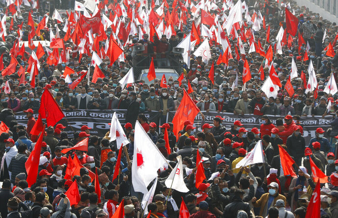 Nepalese supporters of the splinter group in the governing Nepal Communist Party participate in a protest in Kathmandu, Nepal, Friday, Jan. 22, 2021. Thousands of demonstrators rallied in Nepal's capital Friday protesting against the prime minister who had dissolved the parliament and ordered fresh election because of feuds within the ruling political party. (AP Photo/Niranjan Shrestha)