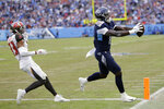 Tennessee Titans wide receiver A.J. Brown (11) catches an 8-yard touchdown pass ahead of Tampa Bay Buccaneers cornerback Carlton Davis (33) in the second half of an NFL football game Sunday, Oct. 27, 2019, in Nashville, Tenn. (AP Photo/James Kenney)