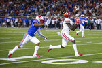Houston wide receiver Marquez Stevenson (5) catches a pass as SMU defensive back Rodney Clemons (8) defends during the first half of an NCAA college football game Saturday, Nov. 3, 2018, in Dallas. Stevenson scored on the play. (AP Photo/Brandon Wade)