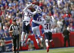 FILE - In this Sept. 29, 2019, file photo, New England Patriots safety Devin McCourty (32) intercepts a pass intended for Buffalo Bills wide receiver John Brown (15) in the first half of an NFL football game, in Orchard Park, N.Y. Despite showing some vulnerability in their loss to the Ravens, the Patriots' defense remains one of the NFL's best heading into the second half of 2019. (AP Photo/Ron Schwane, File)