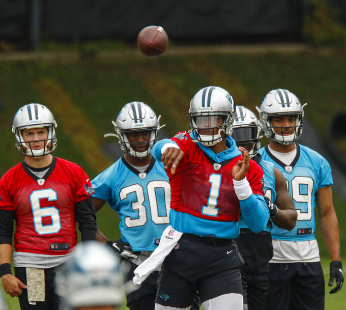 Newton's shoulder chief concern as Panthers report to camp