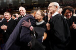 FILE - In this Jan. 25, 2011, file photo, President Barack Obama hugs Supreme Court Justice Ruth Bader Ginsburg on Capitol Hill in Washington,  prior to delivering his State of the Union address. From left are, Chief Justice John Roberts, Justice Anthony Kennedy, Obama, Justice Ginsburg and Justice Stephen Breyer.  Ruth Bader Ginsburg died at her home in Washington, on Sept. 18, 2020, the Supreme Court announced. (AP Photo/Pablo Martinez Monsivais, Pool, File)
