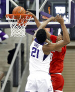 TCU center Kevin Samuel (21) is unable to stop Texas Tech guard Jarrett Culver (23) from dunking the ball in the second half of an NCAA college basketball game in Fort Worth, Texas, Saturday, March 2, 2019. (AP Photo/Tony Gutierrez)