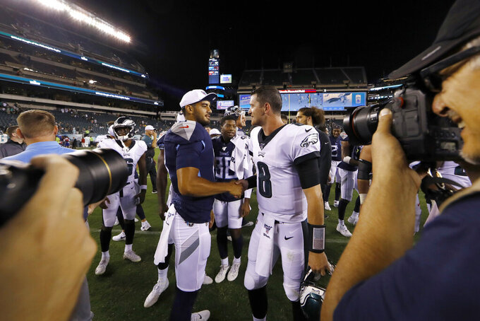 Tennessee Titans' Marcus Mariota, left, and Philadelphia Eagles' Clayton Thorson meet after a preseason NFL football game Thursday, Aug. 8, 2019, in Philadelphia. Tennessee won 27-10. (AP Photo/Matt Rourke)