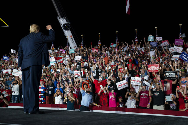 President Donald Trump pumps his fist as he walks off after speaking at a campaign rally at Orlando Sanford International Airport, Monday, Oct. 12, 2020, in Sanford, Fla. (AP Photo/Evan Vucci)