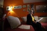 In this picture taken on Friday, Jan. 31, 2020 Yolanda Martinez Garcia reads a letter of her son during an interview with the Associated Press at her home, in Milan, Italy. Her son was sexually abused by one of the priests of the Legion of Christ, a disgraced religious order. (AP Photo/Luca Bruno)