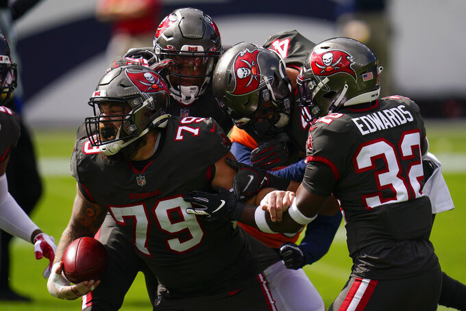 Tampa Bay Buccaneers defensive end Pat O'Connor (79) reacts with teammates after a blocking a punt second half of an NFL football game against the Denver Broncos, Sunday, Sept. 27, 2020, in Denver. (AP Photo/David Zalubowski)