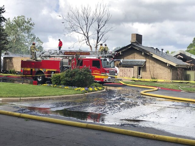 An early morning fire ripped through an empty University of Oklahoma fraternity house Friday, May 8, 2020, but no injuries were reported. There was no one living in the Delta Tau Delta house when the blaze erupted, because students were sent home in March due to the coronavirus. (AP Photo by Sean Murphy)