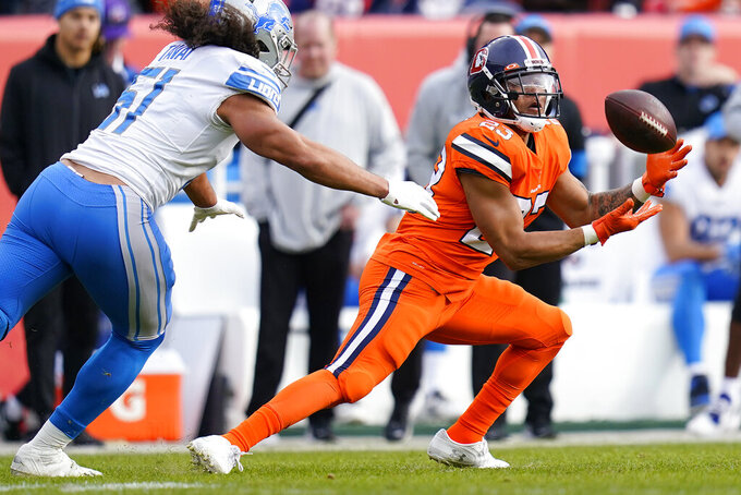 Denver Broncos running back Devontae Booker (23) pulls in a catch as Detroit Lions linebacker Jahlani Tavai (51) pusues during the first half of an NFL football game, Sunday, Dec. 22, 2019, in Denver. (AP Photo/Jack Dempsey)